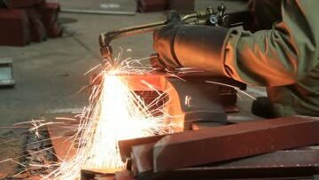 stock-footage-industrial-worker-cutting-steel-by-using-metal-torch
